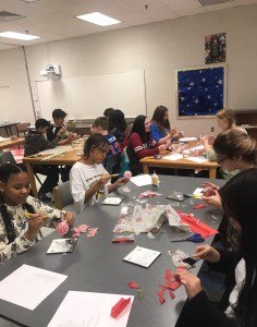 Students making ornaments
