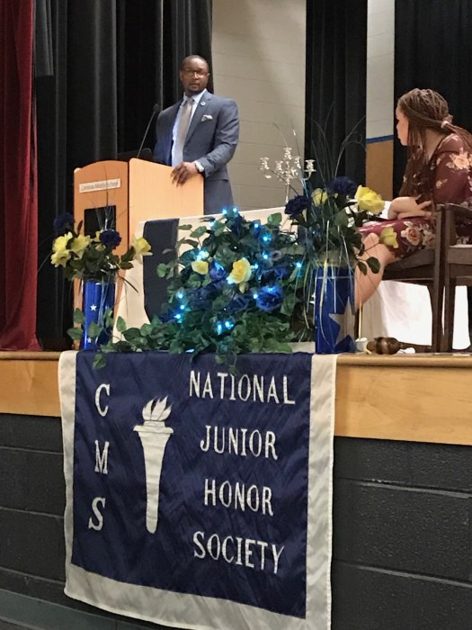 guest speaker and students at NJHS ceremony