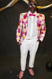 best dressed male student flowered jacket, bow tie, white pants, sunglasses