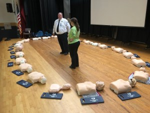 Fire and Rescue representative with mannequins for the students