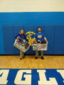 The CMS Athletic Department accepts two totes full of shoes.