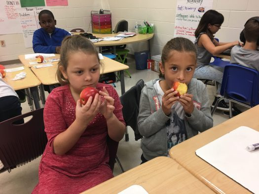 LCES students eating apples for National Crunch Day!