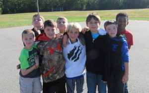 Group of students smiling for the camera during the bully walk.