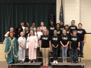 Fifth grade students and the director of the Christmas Carol
