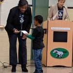 Mrs. Haley giving a certificate to a student
