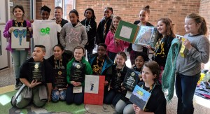 Beta students pose with winning projects