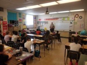 Sergeant Hall speaking to a fifth grade class