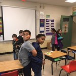Two students leaning on each other