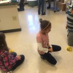 Students working with the BeeBots