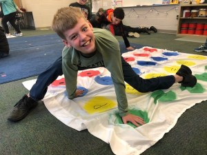 Student on twister board