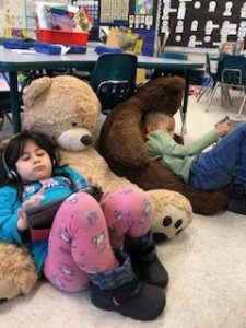 Students working with big teddy bears