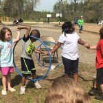 Students playing hula hoop