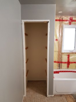 Cabinet beginning to be built in bathroom