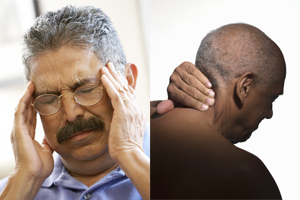 Man holding head.  Man holding neck.
