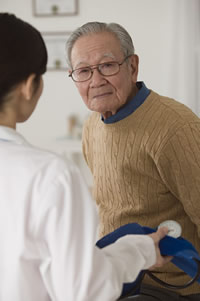 Photo: older adult man with doctor