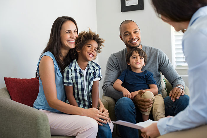 Therapist talking with parents and child