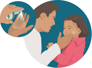 an adult male applying insect repellent to a child's face
