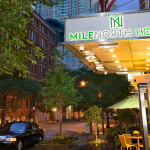 Entrance to MileNorth Hotel shown at night