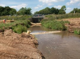 Pollution prevention in stream crossing site