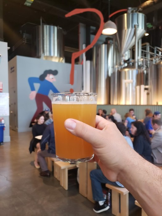 an image of a beer at the old Mikkeller NYC brewery with the decorative pipe of flowing beer to a graphic of a drinker is changed into a question mark