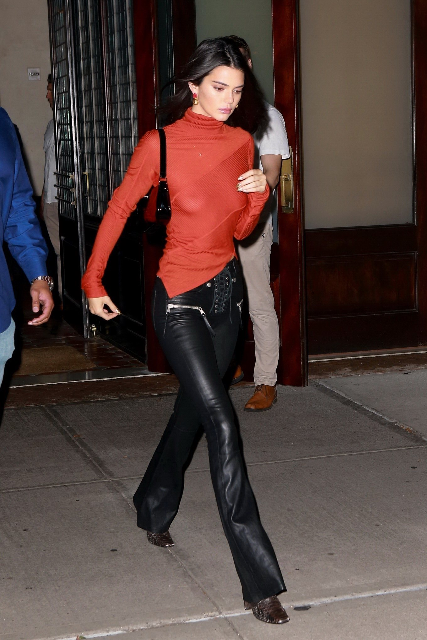 Kendall Jenner braless in a sheer red skivvy top and black