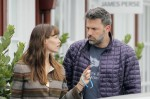 Jennifer Garner and Ben Affleck seen having what appears to be a serious conversation while out shopping and having lunch with their daughters in LA