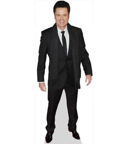 A Lifesize Cardboard Cutout of Donny Osmond wearing a dark coat
