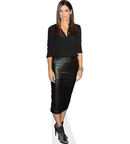 A Lifesize Cardboard Cutout of Sandra Bullock wearing a leather skirt