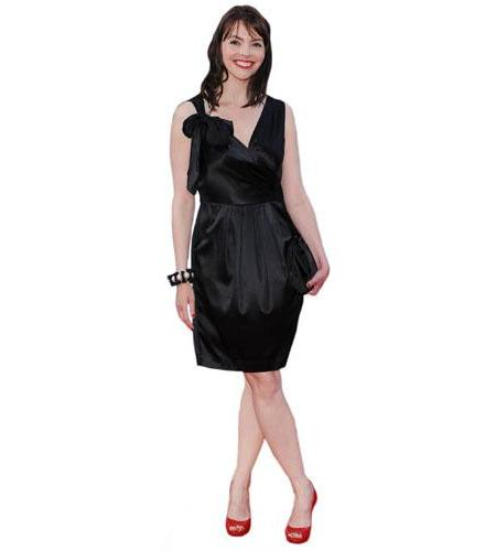 A Lifesize Cardboard Cutout of Kate Ford wearing a short black dress