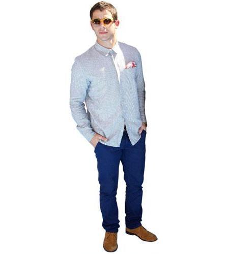 A Lifesize Cardboard Cutout of Nick Jonas wearing shades