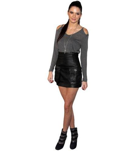 A Lifesize Cardboard Cutout of Kendall Jenner wearing a leather skirt