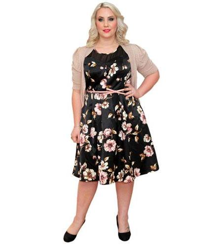 A Lifesize Cardboard Cutout of Claire Richards wearing a floral dress