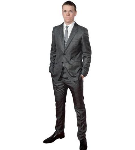 A Lifesize Cardboard Cutout of Will Poulter wearing a suit