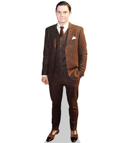 A Lifesize Cardboard Cutout of Evan Peters wearing a brown suit