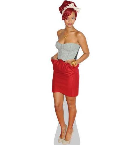 A Lifesize Cardboard Cutout of Rihanna wearing a red dress