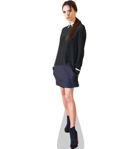 A Lifesize Cardboard Cutout of Victoria Beckham wearing a short skirt