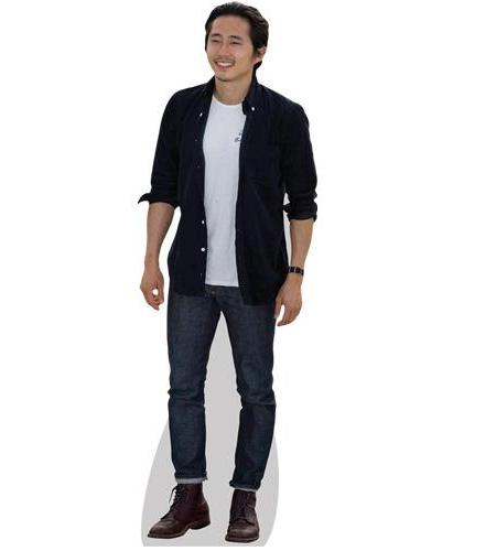 A Lifesize Cardboard Cutout of Steve Yeun wearing jeans