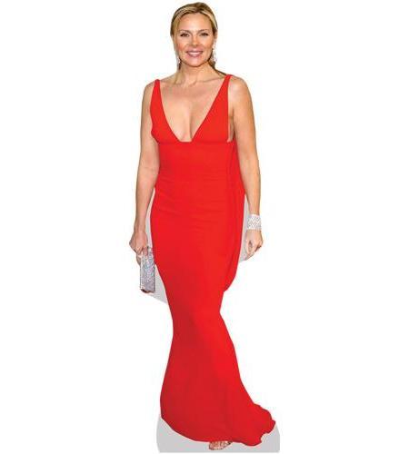 A Lifesize Cardboard Cutout of Kim Cattrall wearing a red dress