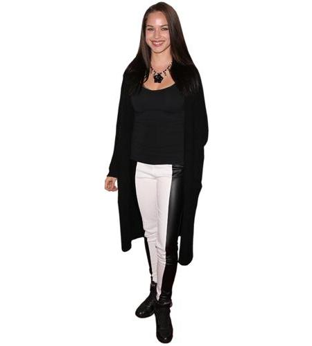 A Lifesize Cardboard Cutout of Alexis Knapp wearing trousers