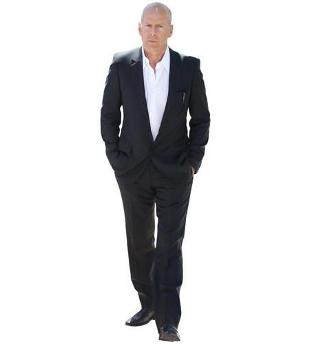 A Lifesize Cardboard Cutout of Bruce Willis wearing a suit