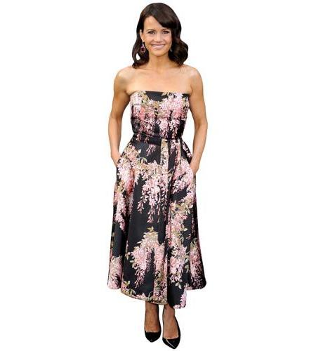 A Lifesize Cardboard Cutout of Carla Gugino wearing a floral dress