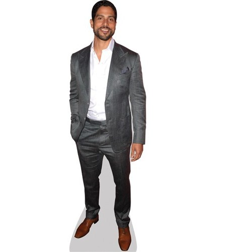 A Lifesize Cardboard Cutout of Adam Rodriguez wearing a suit
