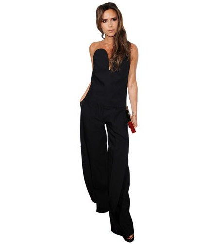 A Lifesize Cardboard Cutout of Victoria Beckham wearing a jumpsuit