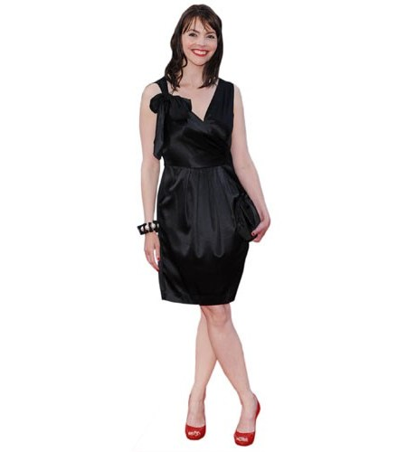 A Lifesize Cardboard Cutout of Kate Ford wearing a short black dress