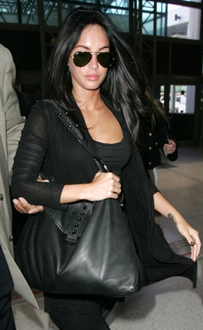 Megan Fox dashes through LAX in Junkie U Cardi
