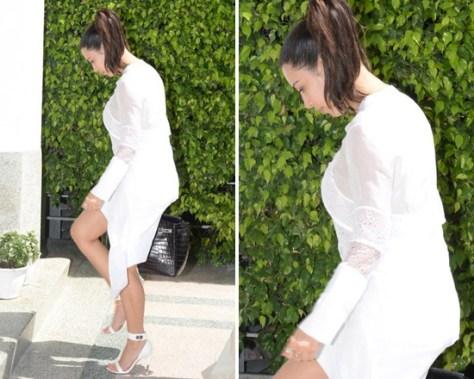 Kim Kardashian wears Givenchy Tiered Chiffon Lace Top with Tails