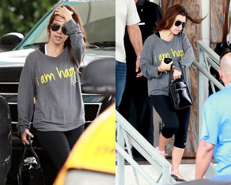 Kourtney Kardashian wearing Peace Love World I Am Happy Oversized Sweater