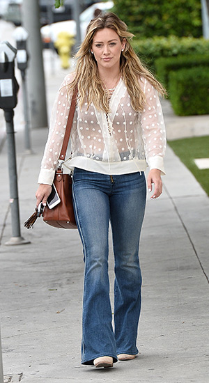 Hilary Duff out running errands in West Hollywood, CA on July 21, 2015 wearing a IRO Oltane Ecru Top, Proenza Schouler bucket bag, McGuire jeans and Rag & Bone booties.