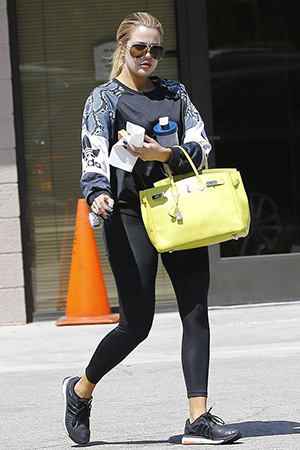 Khloe Kardashian wearing a adidas Originals LA printed jersey sweatshirt while leaving an office building in Hollywood, CA on August 28, 2015.