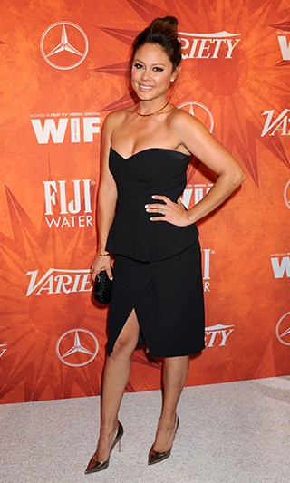 Vanessa Lachey wearing a 10 Crosby Derek Lam Strapless Peplum Dress, Bottega Veneta clutch and gold Sergio Rossi shoes to the Variety And Women In Film Annual Pre-Emmy Celebration in West Hollywood, CA on September 18, 2015.